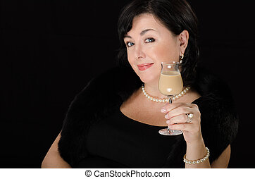 Lady with a glass of cream liqueur