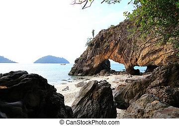 Nature stone arch at Ko Khai island,Lipe, southern of...