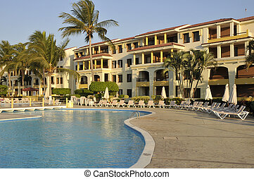 Resort pool and hotel - Swimming pool in a Mexican Resort in...