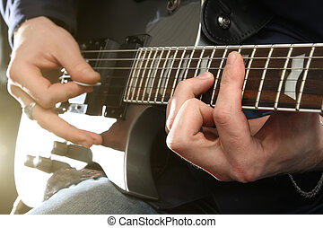 Electric guitar in male hands