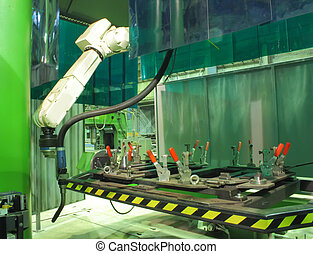 Working welding robot in factory