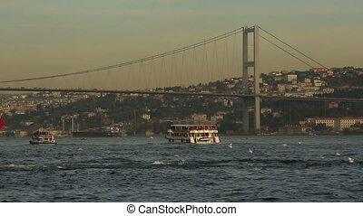 urban transport by sea in front Bosporus Bridge at Istanbul