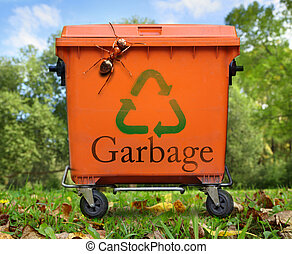 Garbage bin and large ant - Recycled sign on garbage bin and...