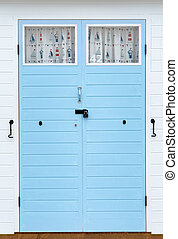 Nautical theme beach hut doors - Doors on beach hut with...