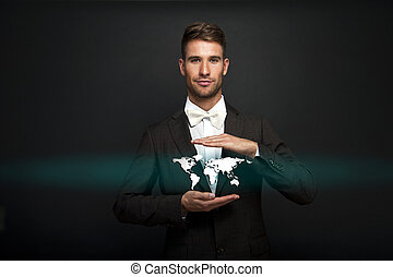 Businessman holding virtual world map