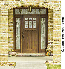 Decorative Front Door View - A view of a decorative brown...