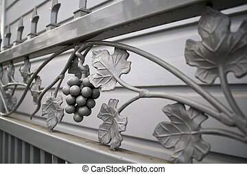 grapevine iron gate - oblique view of grey wroght iron gate...