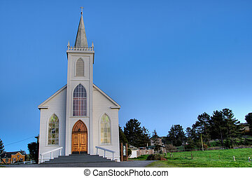Boedga Church distance - a small church on top of o hill in...