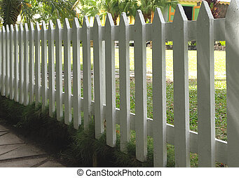 White painted picket fence - A white painted wooden picket...
