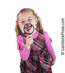 Funny girl showing teeth through a magnifying glass,...