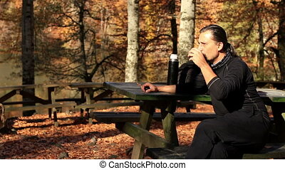 relaxation time - brunette man drinking a break time at...