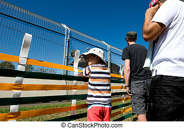 Photos from an international sporting event-people and...