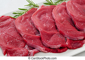 raw beef fillets - closeup of some raw beef fillets on a...