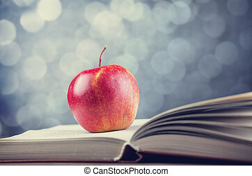 Apple and the book. Photo in old color image style
