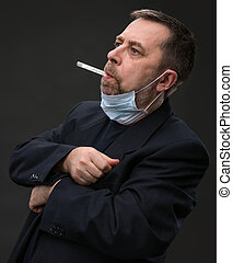 Man in medical mask with a thermometer - Illness Man in...