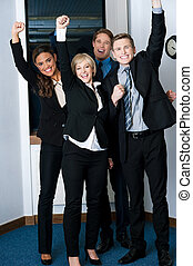 Winners in business, celebrating success - Excited business...