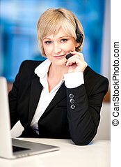 Friendly female operator with headset - Customer support...