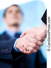 The deal is locked, congratulations - Business handshake...