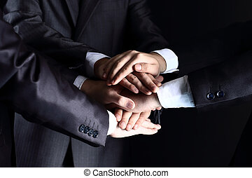 Team work concept Business people joining hands