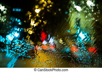 Traffic lights in a wet windshield - Blurred lights in a wet...