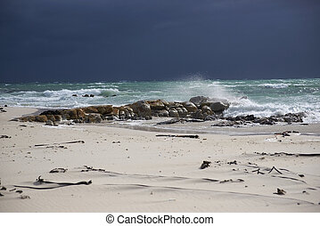 Stormy Sea - Dark clouds over a sunlit stormy sea and sandy...