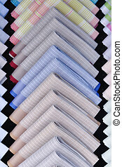 Row of color handkerchiefs for sale.