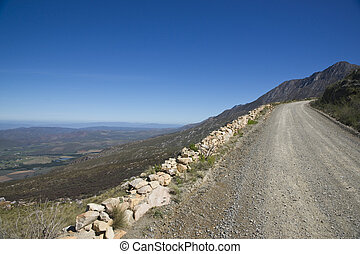 Road to the Swartberg Pass - Gravel road heading up to the...