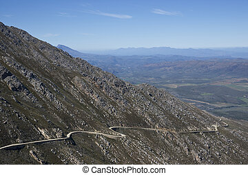 Swartberg Pass - Gravel road hugging the side of a mountain...