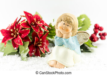 Holy baby Angel with poinsettia - Christmas symbol