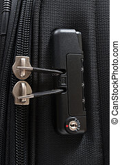 Close up detail of a TSA accepted luggage lock