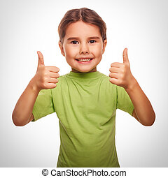 baby girl raised her thumbs up symbol indicates yes