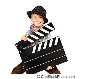 stage director - Cheerful boy holding clapper board....