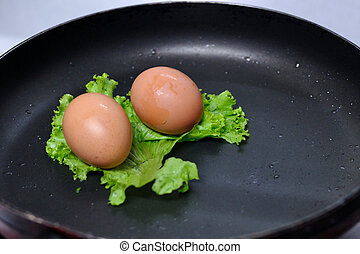 Raw chicken egg in pan, conception.