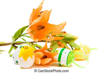 easter egg and orange lily isolated on white