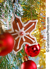 homemade gingerbread cookie hanging on christmas tree -...