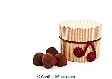 handmade truffles and a gift carton. white background