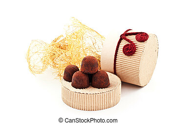 handmade truffles on a cover of gift carton. white...