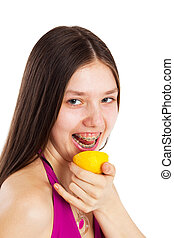 teen with lemon - long hair teen in bikini with piece of...