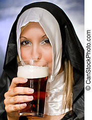 Cheers - A nun wearing a habit sinfully drinking a glass of...