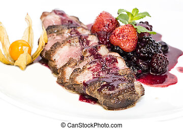 Peking Duck - Peking duck with berry sauce on a white...
