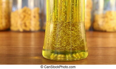 Golden Oil Bubbles Change Direction - Bubbles inside a...