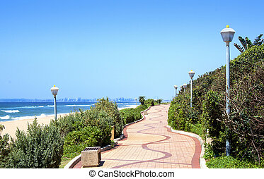 Winding Pedestrian Walkway With Beach And Ocean Backdrop -...