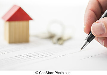 Signing contract of house sale - Closeup of signing contract...