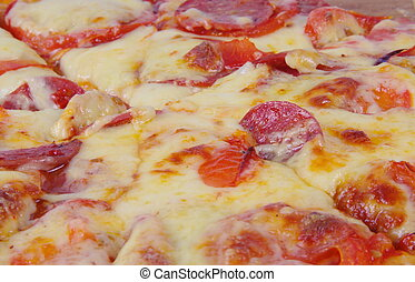 pizza closeup - closeup of delicious pizza with sausages