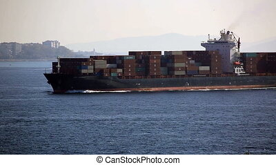 cargo ship - large cargo ship passing Bosporus
