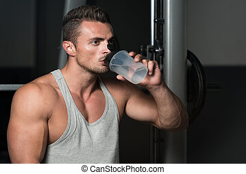 Man Drinking Water After Exercise - Healthy Young Man...
