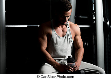 Fit Man Drinking Water - Healthy Young Man Resting And...