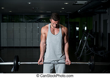 Young Men Doing Heavy Barbell Exercise - Young Athlete In...