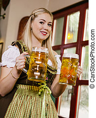 Serving beer at Oktoberfest - Photo of a beautiful female...