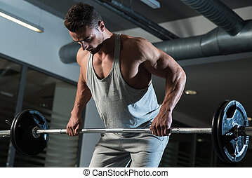 Pain and Gain - Man Doing Heavy Weight Exercise For Back